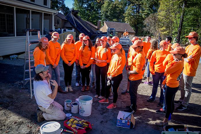 UConn Engineering volunteers receive painting instructions. (Josh Garvey/UConn Photo)
