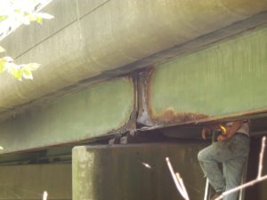 A bridge, showing corrosion of a steel beam. (Photo courtesy of CME Engineering)