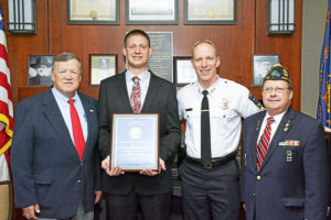 """Contributed photo — American Legion Hayes-Velhage Post 96 The American Legion Hayes-Velhage Post 96 recently recognized West Hartford Police Detective Benjamin Delmonte as the """"2016 Police Officer of the Year."""" Above, from left, are Moe Fradette, Post 96 Commander; Detective Benjamin Delmonte, West Hartford Police Department; Chief Tracy Gove, West Hartford Police Department; and Jeff Cole, Post 96 Vice Commander."""