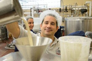 Bill Sciturro pours a test batch of reduced sugar ice cream into a batch freezer at the UConn Creamery on April 8, 2015. (Peter Morenus/UConn Photo)