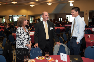 Doug Shidler and his wife, Trish Shidler, speak with a student