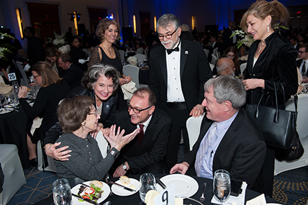 From left are Tina Lewis, the first woman to earn an engineering degree at UConn; Regina Barreca, UConn professor of English literature and feminist theory who introduced a tribute to Lewis; S. Pamir Alpay, professor and department head of materials science and engineering; Kazem Kazerounian, the dean of the School of Engineering, John McNabb, a friend of Lewis; and Susan Herbst, president of the University of Connecticut.