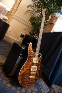 Over 170 items were up for auction at the gala, including a baseball cap worn in space by UConn Alum Rick Mastracchio '82 (ENG), which was auctioned for $1,500. The pictured guitar was auctioned for $350 and signed by Jeff Baxter, one of the founding members of Steely Dan, who was a featured speaker at the event.