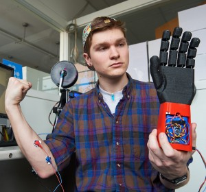 """It would be really cool to take everything I've been working on and apply it in a way that is beneficial, not just, 'oh look, this hand closes when you squeeze your muscle,'"" says Stephen Hawes '17 (ENG). ""To have it actually do something practical for a person, that would be so cool."" (Peter Morenus/UConn Photo)"