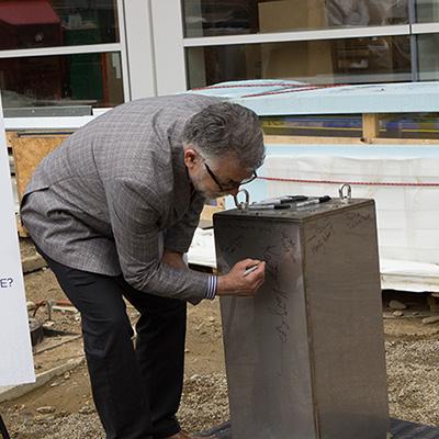 http://news.engr.uconn.edu/wp-content/uploads/Kazem-signing-square.jpg