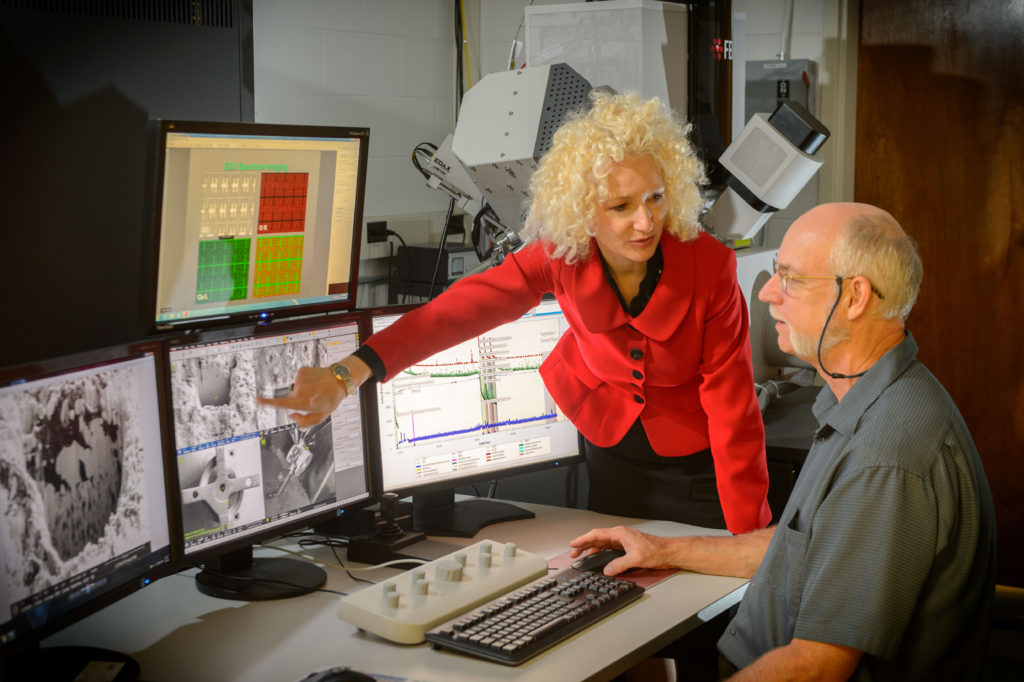 Radenka Maric, of chemical and biomolecular engineering and Roger Ristau, managers of the UConn-FEI Center for Advanced Microscopy and Materials Analysis examine a microscope image on June 22, 2016. (Peter Morenus/UConn Photo)