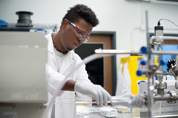 Under UConn leadership, a higher education alliance dedicated to expanding diversity in the STEM fields recently received a grant of $3.5 million to increase its efforts. Here, Nico Wright '18 (ENG) works in Professor Michael Pettes' mechanical engineering laboratory.