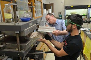Daniel Kloyzner '16 with Richard Parnas, a professor of chemical, materials, and biomolecular engineering, has found a way to turn particle board into carpet. Photo taken on June 18, 2015. (Sean Flynn/UConn Photo)