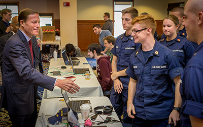 U.S. Senator Richard Blumenthal meets with the cybersecurity competition team from the U.S. Coast Guard.