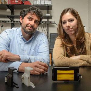 Savas Tasoglu, assistant professor of mechanical engineering, left, and Stephanie Knowlton, a graduate student, with a device to analyze blood for sickle cell disease on Oct. 13, 2015. (Peter Morenus/UConn Photo)