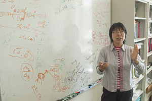 Jinbo Bi talking about her research on  May 29, 2015. (Sean Flynn/UConn Photo)