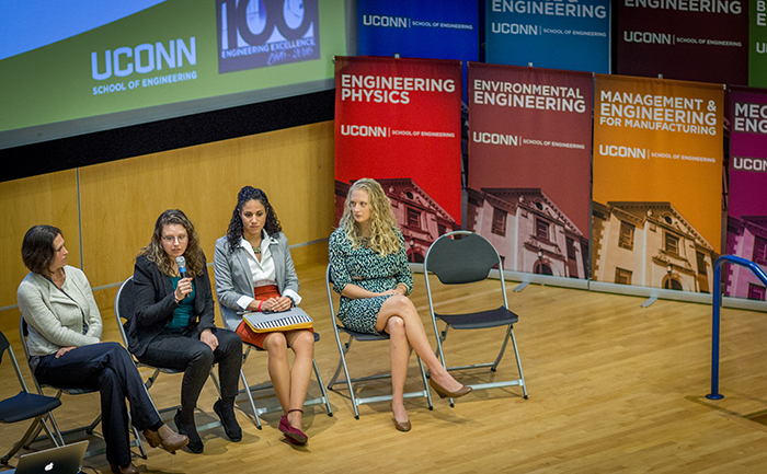 a group of UConn Graduates answers questions of junior and senior high school students. From left are Jayme Coates (M.S. BME, '07; UConn MBA, '10), Erica Kramer (B.S. BME, '08, Ph.D. MSE, '14), Melissa Jacques (B.S. ME, MSE, '10), Caitlin Oswald (B.S., M.S. ME, '09, '14).