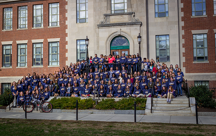 High school Juniors and seniors who came to UConn for the second annual Women in Engineering Day pose outside of the Castleman building. (Christopher LaRosa/UConn Photo)