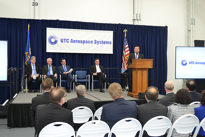 UConn Provost Mun Choi speaks at the February event with UTAS officials and Governor Dannel P. Malloy watching.